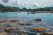 View Of Beautiful Sea-lagoon, Rocks In A Calm Turquoise Water, Colorful Cruise And Fisher Boats, Mou poster