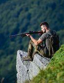 Focused On Target. Hunter Hold Rifle. Hunter Spend Leisure Hunting. Man Brutal Gamekeeper Nature Lan poster
