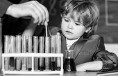 Biotechnology And Pharmacy. Genius Pupil. Education Concept. Talented Scientist. Boy Test Tubes Liqu poster