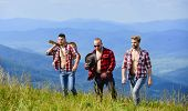 Tourists Hiking Concept. Hiking With Friends. Friendly Guys With Guitar Hiking On Sunny Day. Enjoyin poster