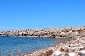 Beautiful Natural Coastline Place. Natural Background Sea Bay With Wild Seashore Stone Beach And Cal poster