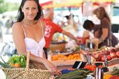 image of local shop  - Woman shopping at an outdoor market - JPG
