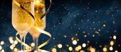 Two Glasses Of Champagne With Golden Confetti, Glitter, Serpentine And Lights. poster