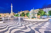 Lisbon, Portugal cityscape at Rossio Square at night. poster
