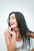 Portrait Of A Beautiful Young Woman In A White T-shirt With Black Hair. Joy And Laughter Degenerate. poster