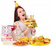 stock photo of bag-of-dog-food  - Woman eating hamburger at birthday - JPG
