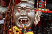 stock photo of nepali  - asian  big religion Buddhism Nepali Mask Street Shop - JPG
