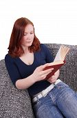woman relaxing with book on couch
