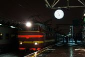 picture of chug  - Night train comes to a railway station - JPG