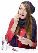 pic of ibuprofen  - cute girl taking drug against a white background - JPG