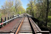 stock photo of trestle bridge  - Seldom used train track and trestle over a small river - JPG
