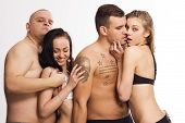 stock photo of swingers  - Sexy swinger foursome in lingerie in studio - JPG
