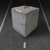 image of restriction  - Roadblock obstacle and barrier business concept with a huge cement or concrete cube barricade blocking a road or highway as a symbol of restricted opportunity or political gridlock resulting in government or financial system shutdown - JPG