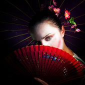 stock photo of geisha  - a portrait of a Geisha with fan and umbrella - JPG