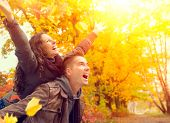 stock photo of flirt  - Happy Couple in Autumn Park - JPG