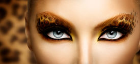picture of animal eyes  - Beauty Fashion Model Girl with Holiday Leopard Makeup - JPG