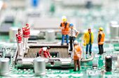 stock photo of circuit  - Team of engineers repairing circuit board - JPG