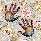 stock photo of palmistry  - colorful floral pattern with human hands the line of life which also form a floral pattern - JPG