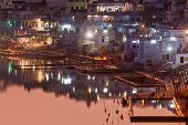 PUSHKAR, INDIA - NOVEMBER 21, 2012: Sacred Puskhar lake (Sagar) and ghats of  town Pushkar in twilig