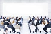 stock photo of seminars  - Large group of business people in presentation - JPG