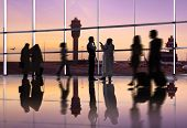 Silhouette of Traveling People at an Airport