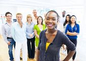 foto of training room  - Beautiful Young African Woman Standing Out of the Crowd in Office - JPG