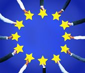 Multi-Ethnic Business Hands Holding Stars To Form The European Union Flag