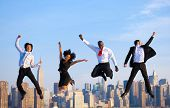 stock photo of facials  - Happy Successful Business People Celebrating and Jumping in New York City - JPG