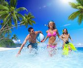 stock photo of samoa  - Beautiful Young People Playing at Tropical Beach - JPG