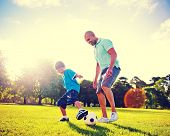 stock photo of pre-adolescent child  - Father and Son Playing Ball in The Park - JPG
