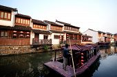 Houses and Boat Along Canal in Suzhou, China