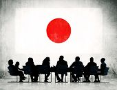Group of Corporate People Having a Meeting Regarding the National Issues of Japan