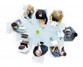 stock photo of tables  - Group Of  Business People Around The Conference Table Having A Meeting - JPG