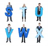 Business People Holding Alphabet and Symbols