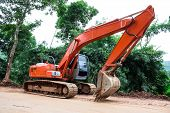 foto of earth-mover  - Heavy earth mover at construction site home - JPG