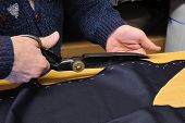 stock photo of tailoring  - Handwork of bespoke suit made by traditional tailoring of Sardinia - JPG