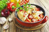 foto of pot roast  - Fricassee of chicken with vegetables in the pot - JPG