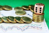 stock photo of copper coins  - Gold coins on a set of stock graphs - JPG