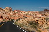 stock photo of valley fire  - The road going through the bright rocks of Valley of Fire State Park located near Las Vegas USA - JPG