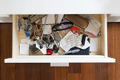 picture of piles  - drawer with a lot of personal items and junk piled up in disarray - JPG