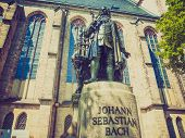 picture of thomas  - The Neues Bach Denkmal meaning new Bach monument stands since 1908 in front of the St Thomas Kirche church where Johann Sebastian Bach is buried in Leipzig Germany - JPG