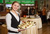 picture of catering  - Catering service employee or waitress posing with a tray of appetizers - JPG