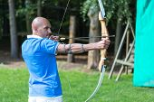 foto of archer  - archer at shooting range with bow and arrow - JPG