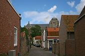 foto of veer  - loooking along cobbled street to church in Veere - JPG