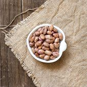 pic of pinto bean  - Pinto beans in a bowl on burlap - JPG