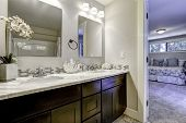 picture of master bedroom  - Decorated bathroom vanity cabinet with mirrors in master bedroom - JPG