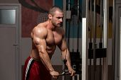 stock photo of light weight  - Young Bodybuilder Doing Heavy Weight Exercise For Triceps - JPG
