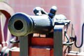 image of cannon  - Old cannon seen up close from the front side of the barrel - JPG