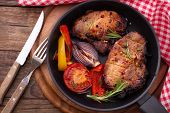 stock photo of pepper  - Food meat barbecue with vegetables on wooden surface - JPG