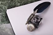 picture of inkwells  - antique vintage blue pen and inkwell on the paper - JPG